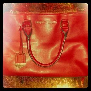 Christian Siriano red purse
